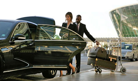 Chauffeur with limo for airport limo service in Toronto, ON
